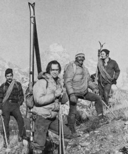Bill Briggs and others hiking with their skis