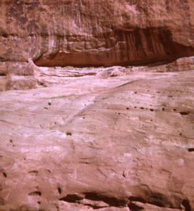 Woman hiking to cliff dwelling